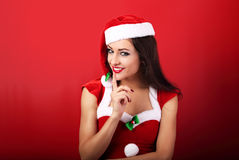 Beautiful woman with toothy smile in santa claus christmas costu Royalty Free Stock Photo