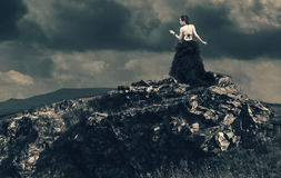 Beautiful woman on top of a mountain. Royalty Free Stock Image