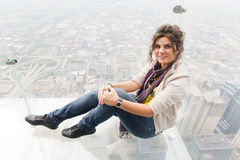 Beautiful woman on top of Willis tower in Chicago Stock Images