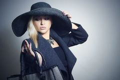 Beautiful Woman in Topcoat and Hat.with Handbag Royalty Free Stock Photo