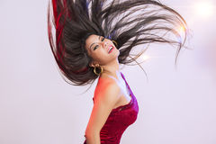 Beautiful woman tossing her hair stock photos