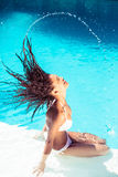 Beautiful woman tossing her wet hair Stock Image