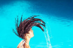 Beautiful woman tossing her wet hair Stock Photo