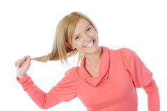 Beautiful woman touches her hair. Royalty Free Stock Images