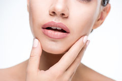 Beautiful woman touching face Stock Images