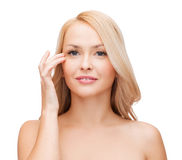 Beautiful woman touching her eye area Stock Images