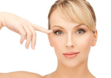 Beautiful woman touching her eye area Stock Image