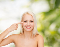 Beautiful woman touching her eye area Stock Photography