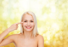 Beautiful woman touching her eye area Stock Photography