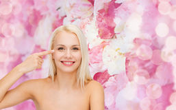 Beautiful woman touching her eye area Royalty Free Stock Images
