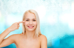 Beautiful woman touching her eye area Royalty Free Stock Photography