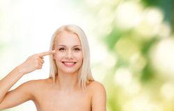 Beautiful woman touching her eye area Stock Photos