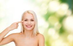 Beautiful woman touching her eye area Stock Photos