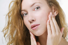 Beautiful woman touching her face Royalty Free Stock Photos