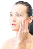 Beautiful woman is touching her face Stock Photo