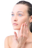Beautiful woman is touching her face Stock Photography