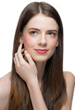 Beautiful woman touching her face Stock Images