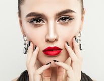 Beautiful Woman Touching her Face her Hand with Manicure. Black Nails and Makeup Lips with Red Color Lipstick Royalty Free Stock Images