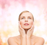 Beautiful woman touching her face and looking up Royalty Free Stock Photos