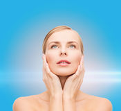 Beautiful woman touching her face and looking up Royalty Free Stock Images