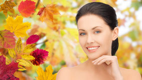Beautiful woman touching her face over autumn Royalty Free Stock Images