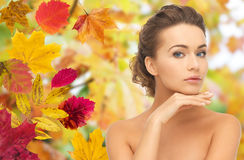 Beautiful woman touching her face over autumn Stock Images