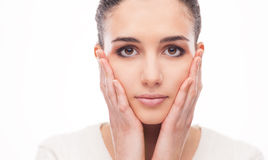 Beautiful woman touching her face Royalty Free Stock Photo