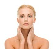 Beautiful woman touching her face skin Stock Photos