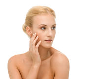 Beautiful woman touching her face skin Royalty Free Stock Image