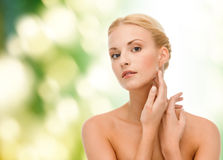 Beautiful woman touching her face skin Royalty Free Stock Photo