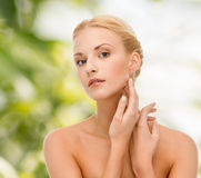 Beautiful woman touching her face skin Stock Images