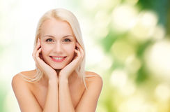 Beautiful woman touching her face skin Royalty Free Stock Photography