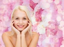 Beautiful woman touching her face skin Royalty Free Stock Photos