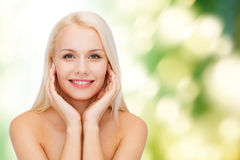 Beautiful woman touching her face skin Stock Photos
