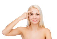 Beautiful woman touching her forehead Stock Photos