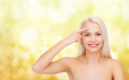 Beautiful woman touching her forehead Stock Photo