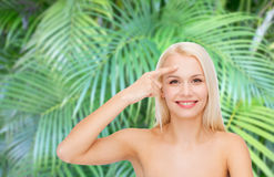 Beautiful woman touching her forehead Royalty Free Stock Photos