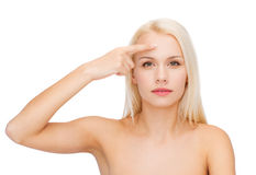 Beautiful woman touching her forehead Royalty Free Stock Images