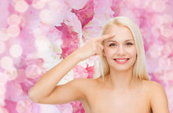 Beautiful woman touching her forehead Stock Images