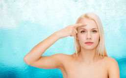 Beautiful woman touching her forehead Stock Photography