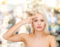 Beautiful woman touching her forehead Stock Image