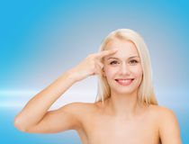 Beautiful woman touching her forehead Royalty Free Stock Image