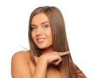 Beautiful woman touching her hair Stock Photo