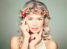 Beautiful Woman Touching Her Hand Her Face. Nice Model in Flower Royalty Free Stock Photos
