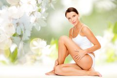 Beautiful woman touching her hips Stock Photography