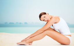 Beautiful woman touching her legs Royalty Free Stock Photography