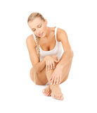 Beautiful woman touching her legs Royalty Free Stock Photos