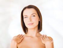 Beautiful woman touching her shoulders Stock Photos