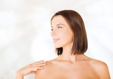 Beautiful woman touching her shoulders Stock Photography