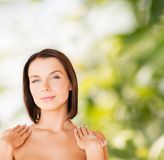 Beautiful woman touching her shoulders Royalty Free Stock Photo